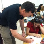 Mr.Weiner assisting student Lilian Morales on her assignment.