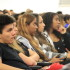 Students attentively listen to speaker, Mrs. Suarez.