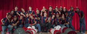 The 21 Mr. Coral Gables contestants pose before performing their opening act.