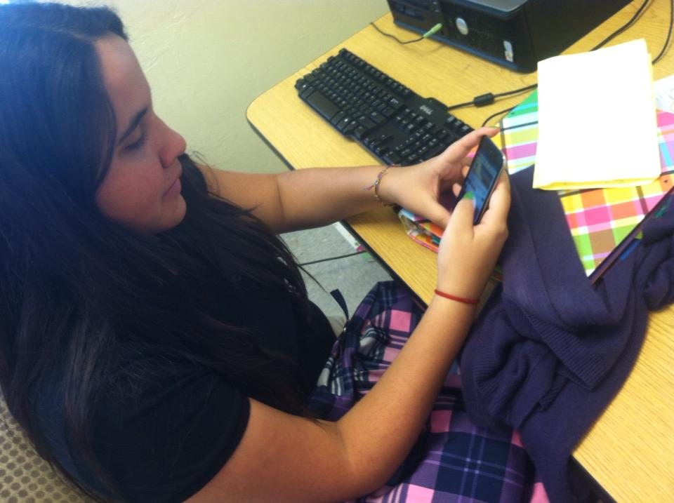 Student Paola Carpio checking her Instagram on her free time.