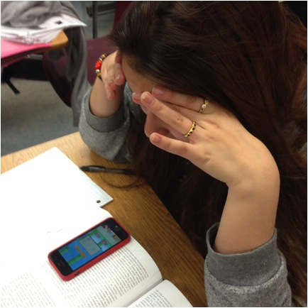 Sophomore Natalia Perez is frustrated after she lost, right before she beat her highest score.