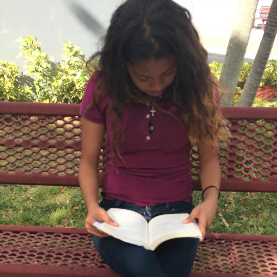 Freshman Ana Urueta is in love with Thirteen Reasons Why by Ray Asher.