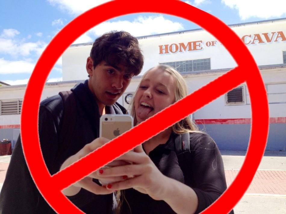 Freshman+Cassidy+Wall+and+senior+Christian+Diaz+take+countless+selfies%2C+behavior+that+Britain+announced+on+April+Fools%27+Day+it+was+banning.+