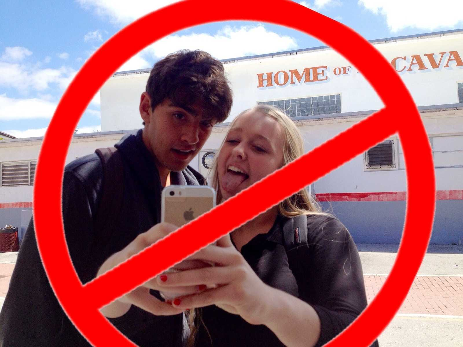 Freshman Cassidy Wall and senior Christian Diaz take countless selfies, behavior that Britain announced on April Fools' Day it was banning.