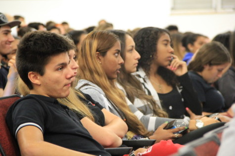 Students attentively listen to speaker, Mrs. Suarez.