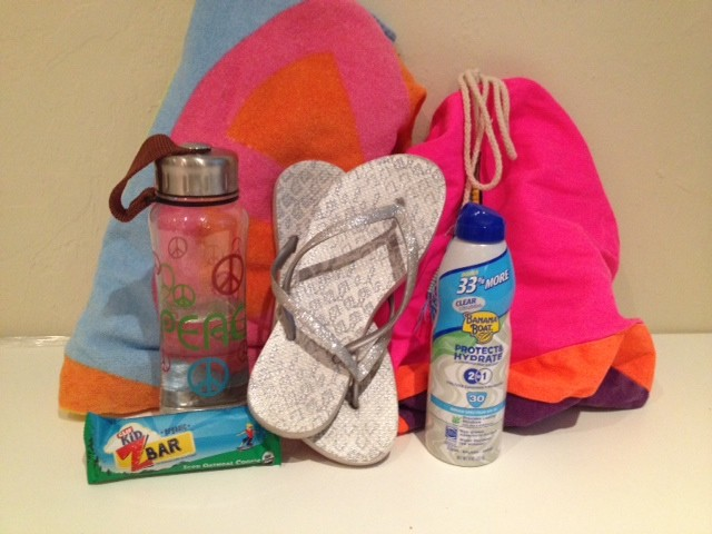 A towel, beach bag, water bottle, snack, flip flops, and sunscreen are important things to pack for a day at the beach.