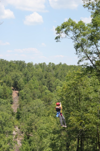 Claire zip lining in Arkansas near Hot Springs in the Ozark Mountains.