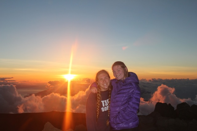 Claire and Camila at the top of the Haleakala Crater at sunset in Maui. The crater is the largest dormant volcano in the world at over 10092 feet.