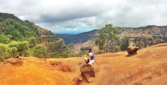 Claire resting while hiking at Waimea Canyon, Kauai, Hawaii. This site is known as the Grand Canyon of Hawaii.