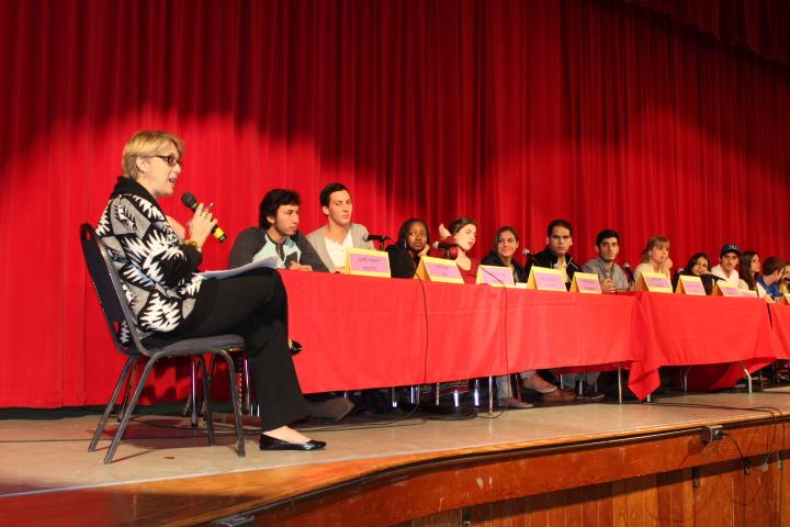 CAP adviser Mrs. Stack leads an assembly where Gables alumni share their college experiences.