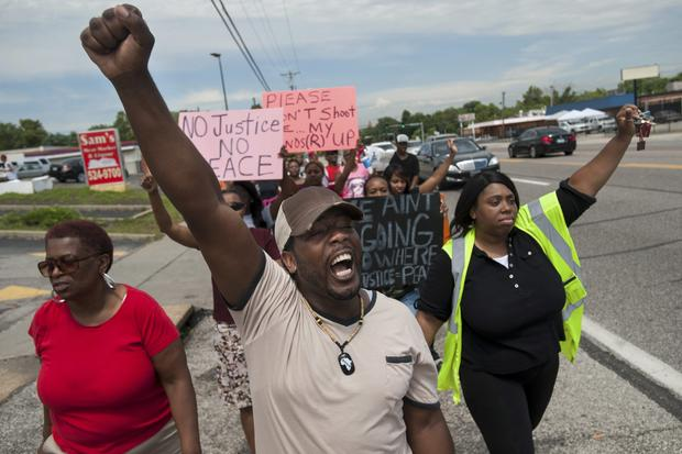 Protestors march in Ferguson, Missouri in response to the death of teen Michael Brown.