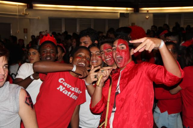 Spirited Cavaliers pose in celebration of Color War.