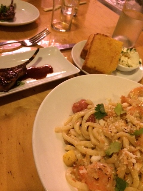 Gigi offers a diverse menu, such as lamb lollipops, cornbread with honey bacon butter, and shrimp udon, pictured above.