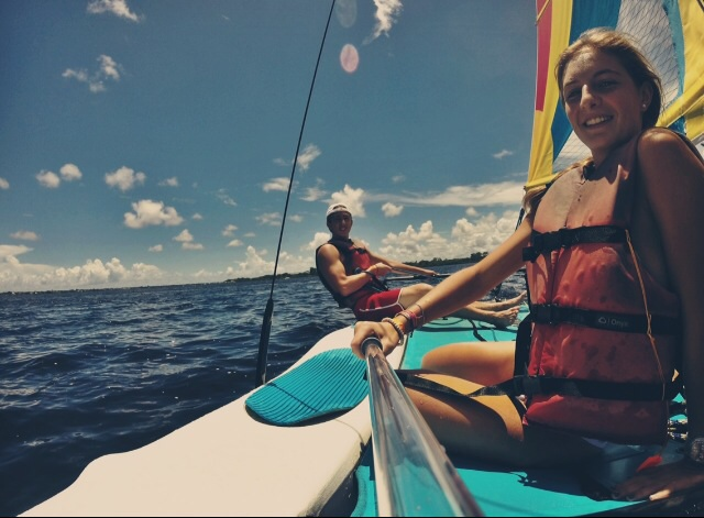 Junior Olivia Garnica and Gables alumnus Jacob Slosbergas enjoy their date by sailing.
