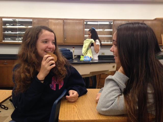 Sophomores Amanda Hopkins and Arden Avera share a laugh as they eat a ginger snap cookie.