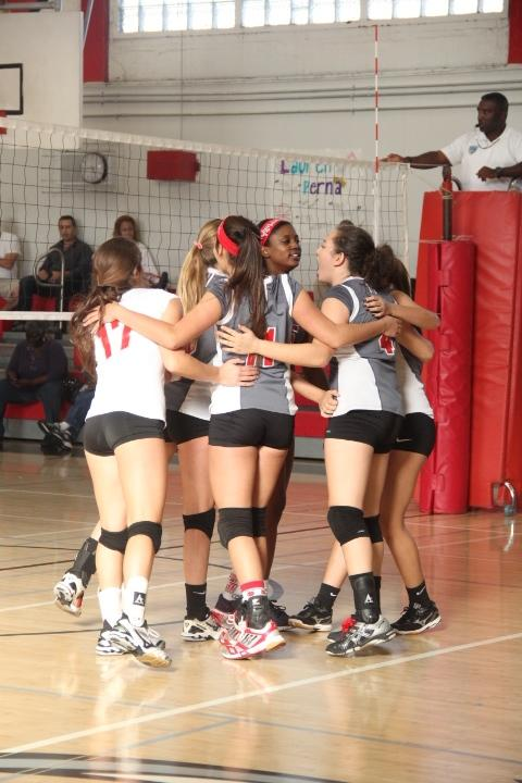 The girls huddle as a team.