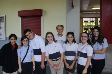 Tour Guide and Sophomore Class President Holden Payne stands with a group of visiting 8th graders as he prepares to give them a tour of Gables.