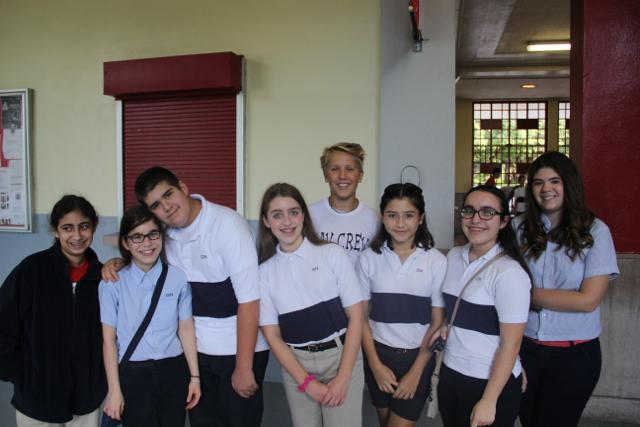 Tour+Guide+and+Sophomore+Class+President+Holden+Payne+stands+with+a+group+of+visiting+8th+graders+as+he+prepares+to+give+them+a+tour+of+Gables.