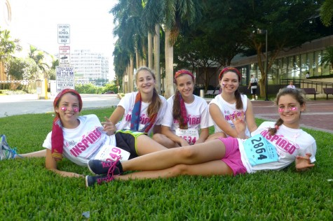 Junior Eleonor Bauwens (back left) participated in Susan G. Komen's