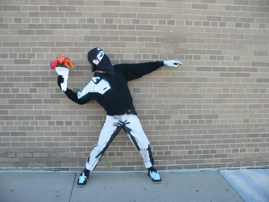 Flower Bomber: Hold this iconic pose when taking pictures.