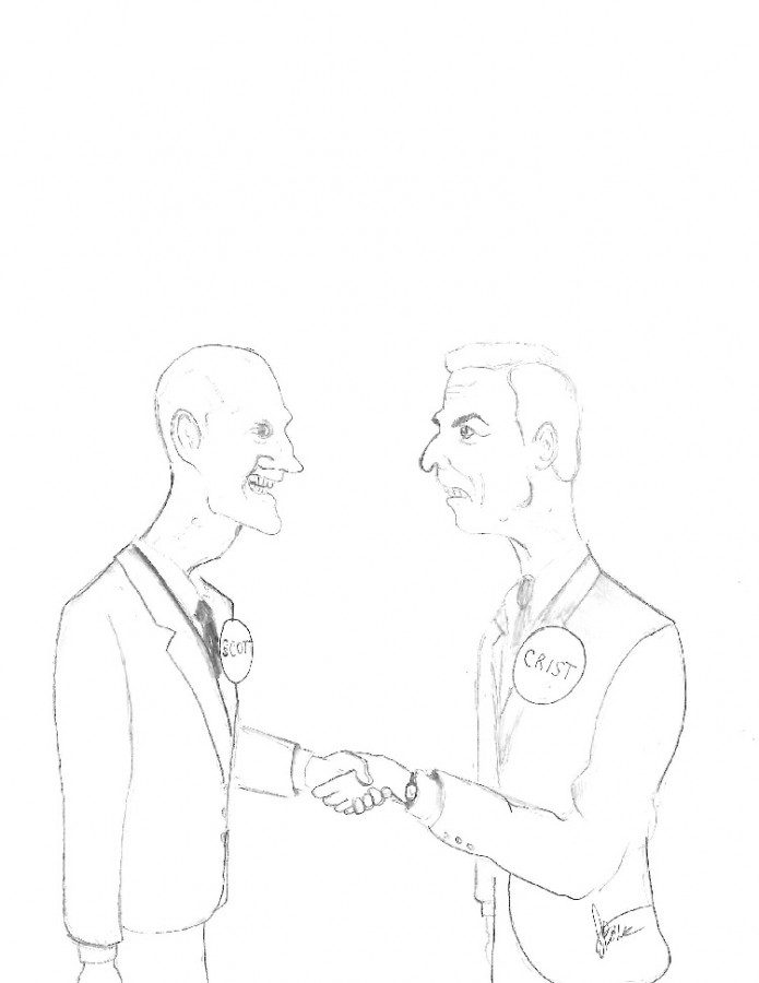Rick Scott and Charlie Crist shaking hands after a long debate.