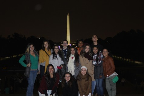 Students from four out of five CAFDM publications stand near the Washington Monument with Ms. Zaldivar and Mrs. Gonzalez.