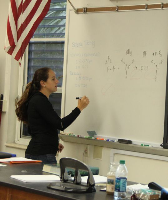 Ms. Fraga displays a Chemistry equation on the board for her students.
