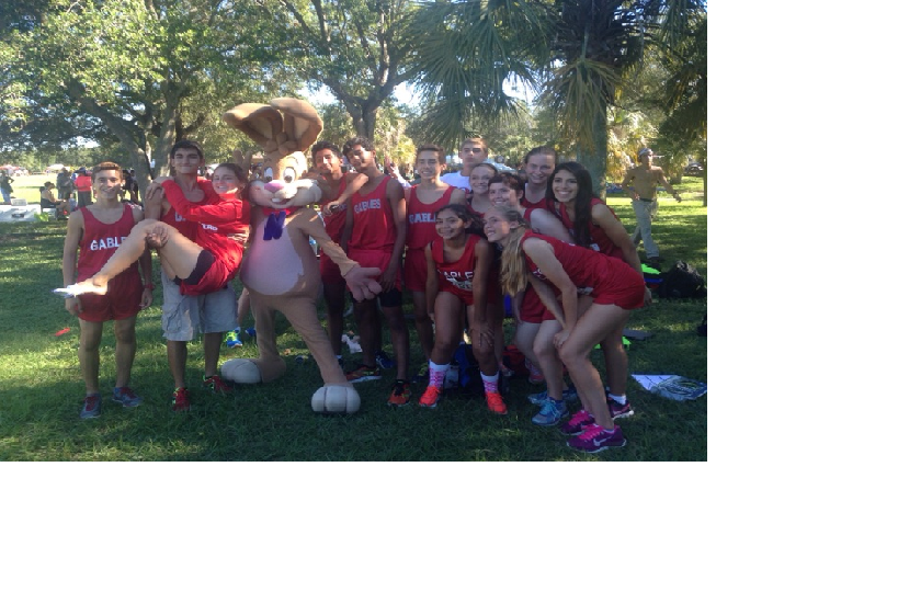 The XC team posses with one of the mascots at the regionals meet.