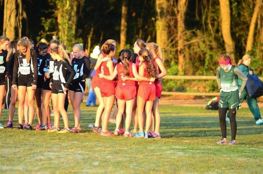 Girls cross country top-seven huddles prior to the state final race in Tallahassee on Saturday, Nov. 15.