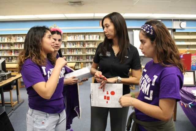 Ms. Zuniga and yearbook students prepare their presentation for the incoming freshmen.