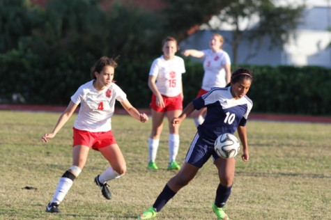 Sophmore Amy Ransom going against one of the Coral Park players.