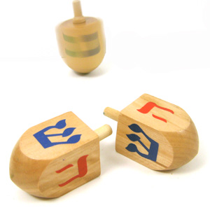 Playing dreidel is a amusing and traditional Hanukkah game.