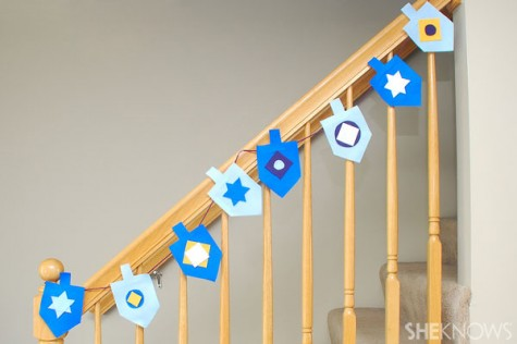 Creating a dreidel garland with felt or paper is a craft that can also serve as a decoration.