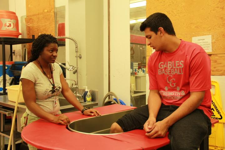 Ms.Singleton helping out a student in the whirlpool