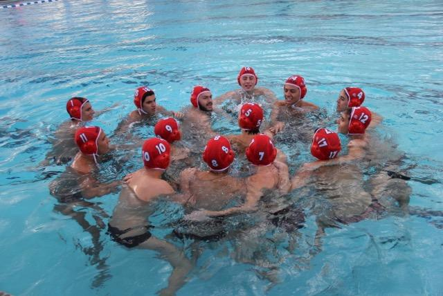The boys Water polo team huddled before the game.