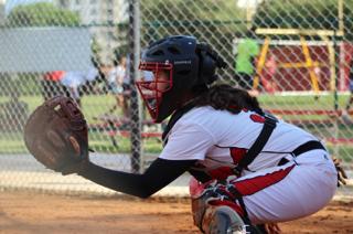 This softball player got her catcher's mitt ready.