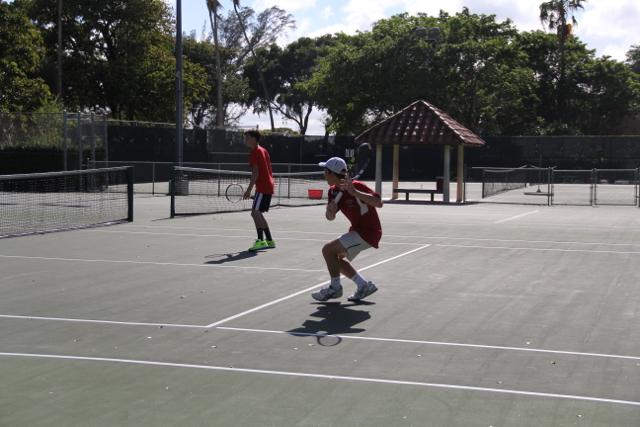 Gables starting their doubles match against Ferguson