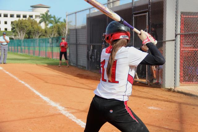 Number 11 winds up for a swing in the game against Ferguson.