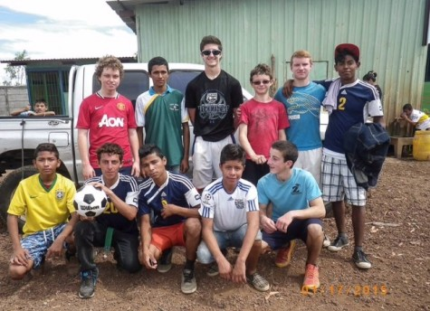Zack Walsh (back row, far left)  posing with participants following his soccer clinics in Tipitapa, Nicaragua.