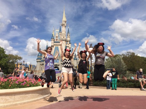 Wang and her friends jump for joy on their senior trip, Grad Bash.