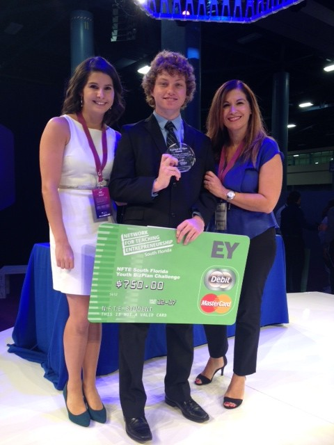 Walsh poses after he won third place in the eMerge America's Competition.