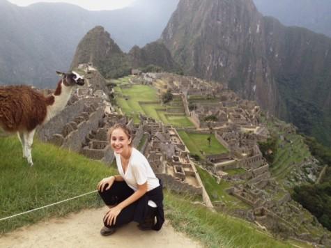 Senior Eleonor Bauwens smiles with a llama in Peru.