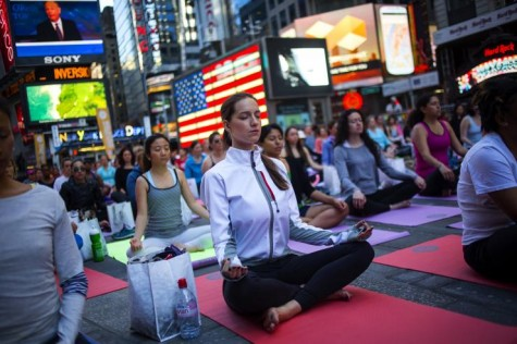 People gather in Times Square to practice Yoga during the Summer Solstice