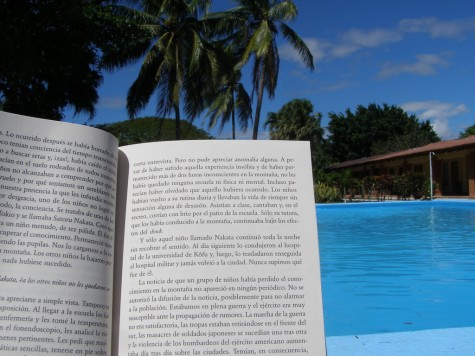A slightly educational summer- finishing up summer reading by the pool.