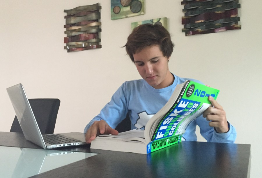 Senior Ivan Grela begins his college search by flipping through his copy of the