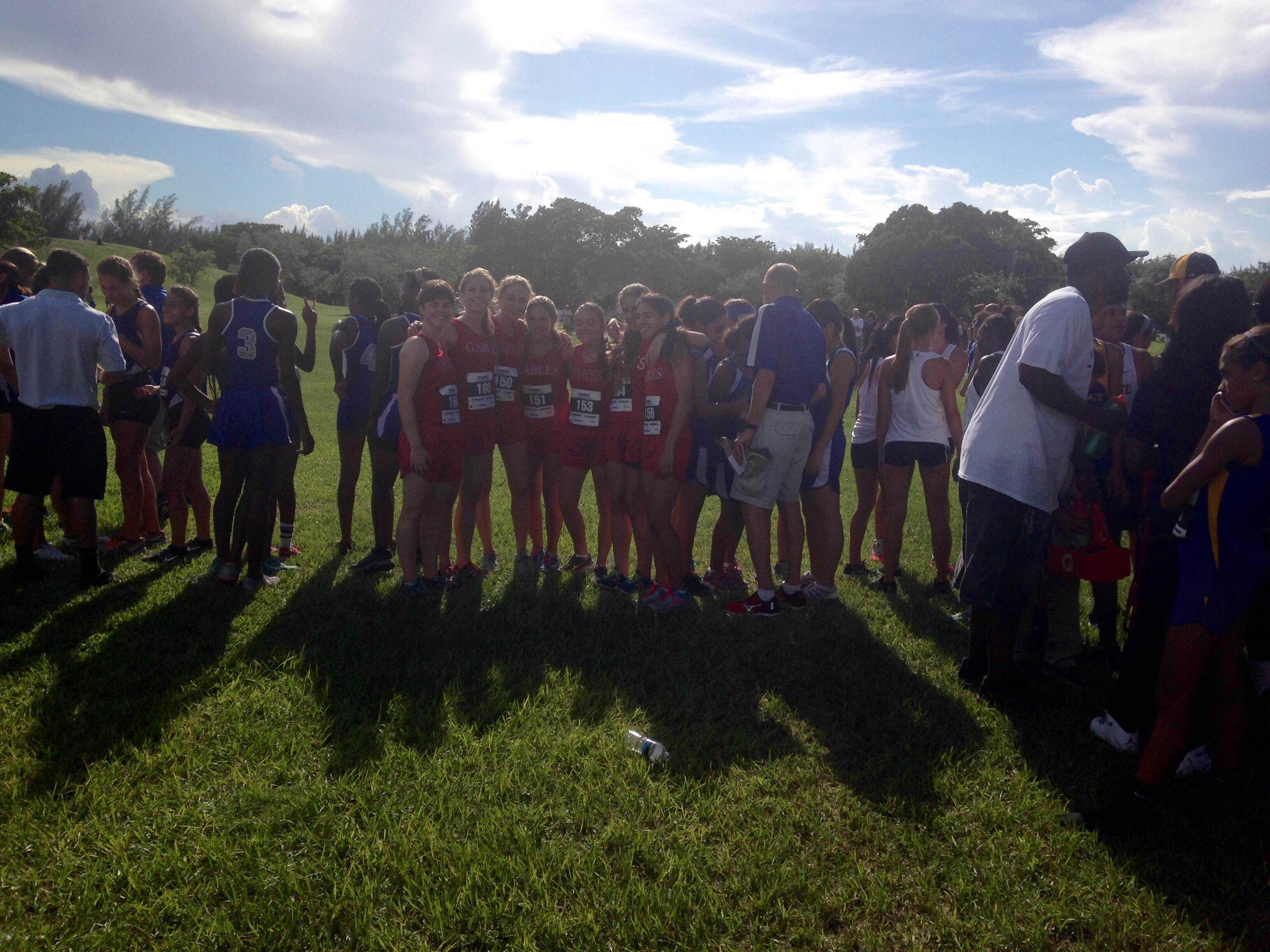 The girls' cross country team huddle for the meet.