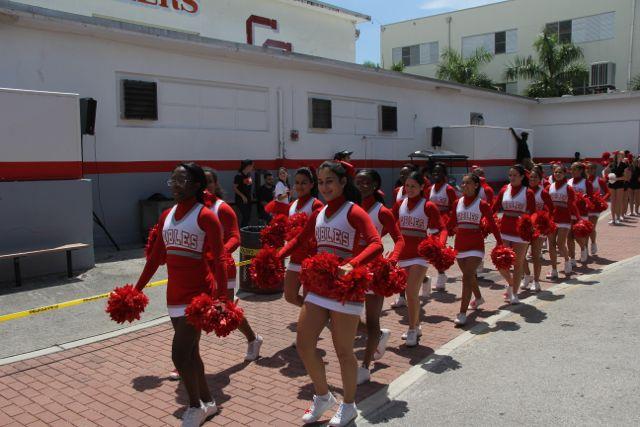 The cheerleaders prepare to perform.