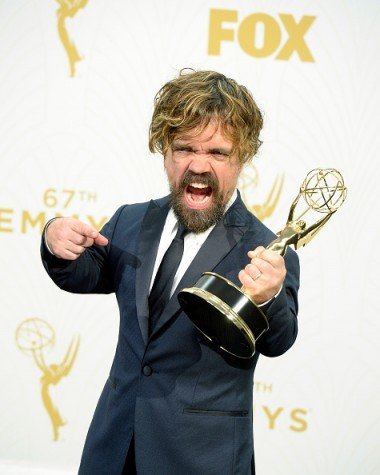 Peter Dinklage Of Game of Thrones posing with his Emmy.