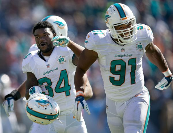 The Dolphins celebrating their long awaited and needed win.