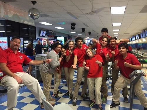 The bowling team celebrates after a tough win.